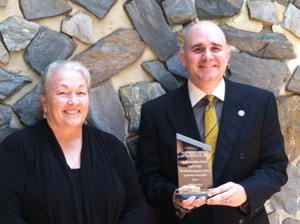 Dr. Ann-Marie Clark and Dr. Allen Bryant with award